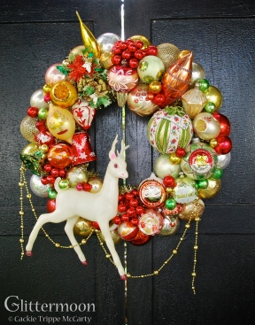 "Christmas Tapestry - A stunning and unique color palette plus some huge pieces make this one a real showstopper. The reindeer alone is too, too much. Oh, and check out that big tapestry ball - wow. Approx 25"" tall (including garland) by 19"" wide - about 20"" diameter $295 *SOLD*"